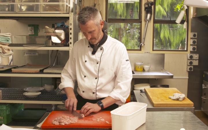Head chef Hamish Blair hard at work in Larnach Castle's kitchen.