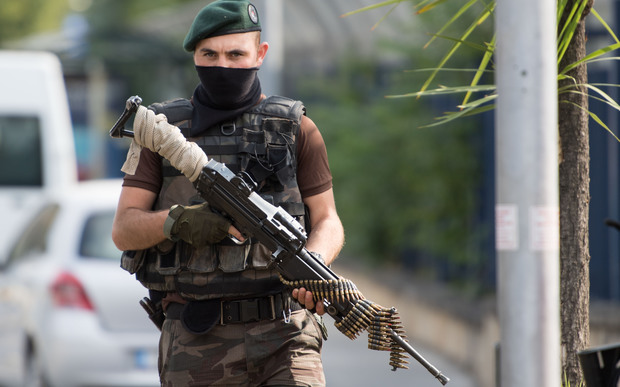 A special police officer stands guard during an operation at the Attatürk Airforce Acadamy in Istanbul, Turkey, following the failed coup attempt.