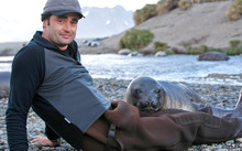 Rob Suisted with Elephant Seal pup on South Georgia