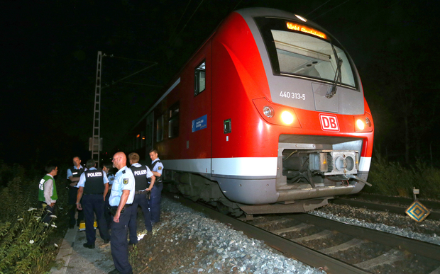 Police officers stand by a regional train in Wuerzburg in southern Germany on July 18, 2016