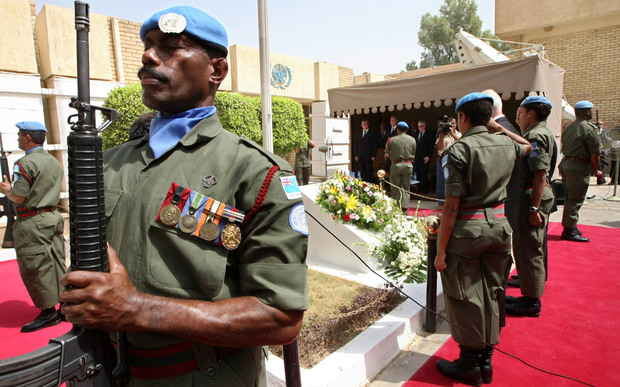 Members of the Fiji Islands UN peackeeping troops perform a guard honour at a memorial monument in the UN headquarters in Baghdad's Green Zone on August 13, 2008.