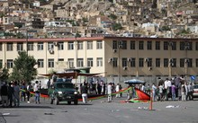 Afghan protesters from Hazara minority stand at the blast site after a suicide attack in Kabul, Afghanistan.