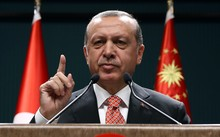 Turkish President Recep Tayyip Erdogan speaks to people demonstrating against the failed military coup attempt.