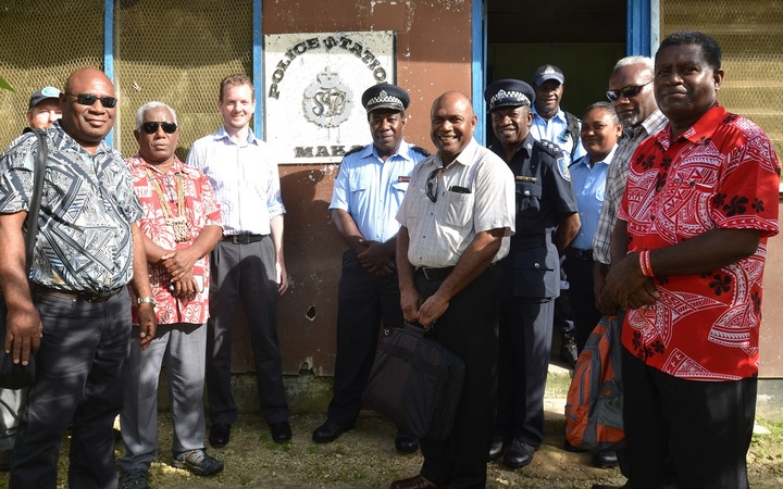 From left to right, Minister for Tourism, Bartholomew Parapolo, MP for Small Malaita Rick Hou, RAMSI Special Coordinator Quinton Devlin, PS Police Edmond Sikua and PS Tourism Andrew Nihopara, Premier of Malaita Peter Ramohia and RSIPF officers at Maka Police Station, South Malaita.