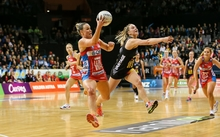 NSW Swift's Kimberlee Green takes a pass under pressure from Waikato BOP's Jamie-Lee Price during the ANZ Netball Championship semi final.