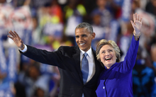 US President Barack Obama, left, waves with US presidential nominee Hillary Clinton during the third night of the Democratic National Convention in Philadelphia on 27 June (US time).