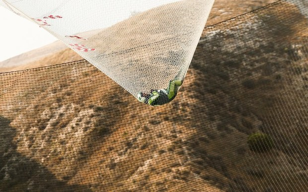 Skydiver Luke Aikins lands safely after jumping 25,000 feet from an airplane without a parachute or wing suit.