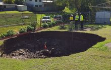 A sinkhole that opened up in an Australian backyard.