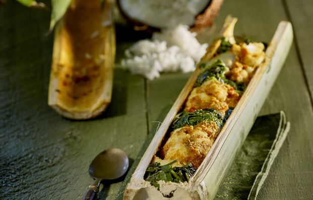 Curried fish in bamboo with coconut rice
