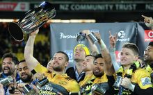 Hurricanes captain Dane Coles with the Super Rugby trophy following the win over the Lions in Wellington.