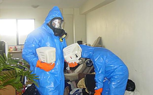 Workers at a contaminated site.
