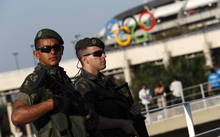 Brazilian security forces stand guard outside the Maracana stadium in Rio de Janeiro, ahead of the opening ceremony.