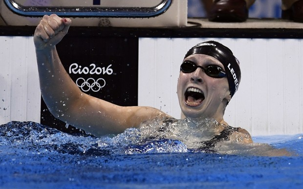 US swimmer Katie Ledecky celebrates breaking her own world record for the women's 400m freestyle at the Rio 2016 Olympic Games on 8 August 2016 (NZT).