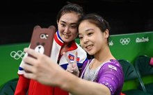 Lee Eun-ju of South Korea and Hong Un-jong of the North pose for a photo together.