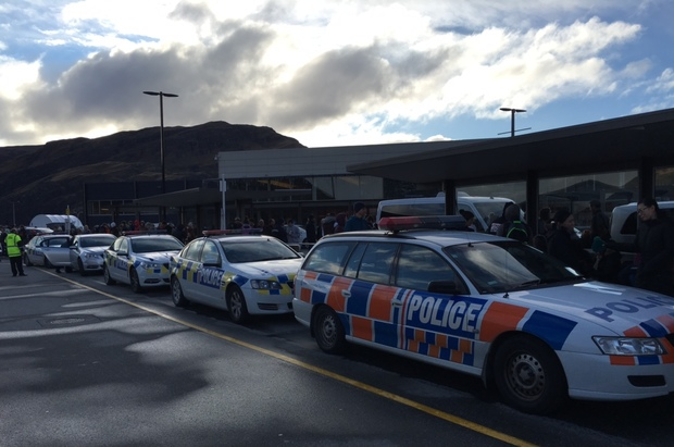 Police cars outside Queenstown airport after it was evacuated.