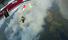 A smokejumper from West Yellowstone, Montana jumps the Bear Lake Fire, August 24, 2014