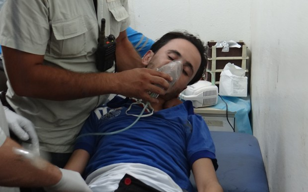 A man receives treatment after a suspected gas attack on the Syrian town of Saraqeb earlier in August.