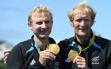 Hamish Bond, left, and Eric Murray celebrate with their gold medals on the podium after wining the Men's Pair Final of the Rowing events of the Rio 2016 Olympic Games at Lagoa Stadium in Rio de Janeiro, Brazil, 11 August 2016.