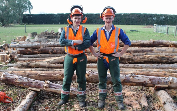Year 12 students James Arnold and Mathew Reed learn how to use a chainsaw.