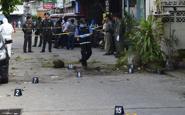 Thai police gather evidence evidence after one of a string of bombs exploded in the resort town of Hua Hin.