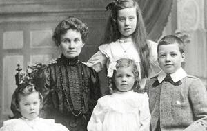 Marshall Walker's grandmother Isa with her children. Marshall's mother Nora is front centre and the boy is uncle Marshall.