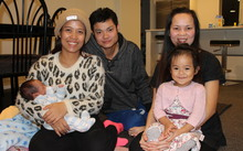 A photo of Vanny Yun with baby Sondra, her husband Sally Yen and Houng Yen holding Vanny and Sally's daughter, Sonila
