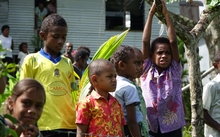 The children of Nawaisomo in the Fiji highlands are getting used to choppers landing in their remote village