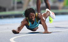 The Bahamas' Shaunae Miller crosses the finish line to win the 400m final at Rio on 15 August (Brazil time).