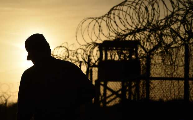 A US soldier walks next to a razor wire-topped fence at an abandoned detention facility at the US Naval Station in Guantanamo Bay (file).