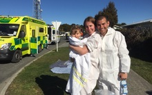 Alison, Mark and Barney Hossain after the decontamination shower.