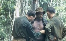 An Australian medical officer treating the New Zealand W Company during a resupply in the field during the Vietnam War.