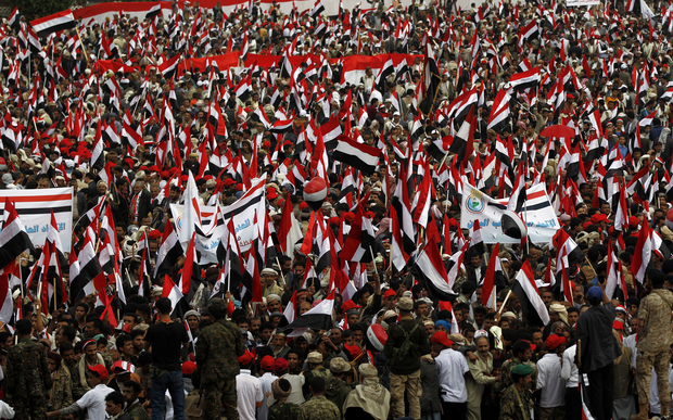 Yemenis waving the national flag during the protest.