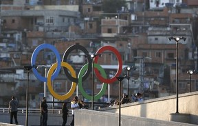 Olympic rings overlook a favela outside the Maracana stadium in Rio.