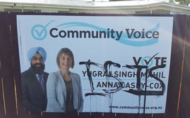 The billboard showing Yugraj Singh Mahil and another candidate Anna Casey-Cox which was defaced and has now been removed.