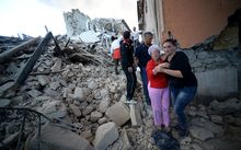 Residents among the rubble after a strong eartquake hit Amatrice on August 24, 2016 Central Italy was struck by a powerful, 6.2-magnitude earthquake in the early hours, which has killed at least three people and devastated dozens of mountain villages.