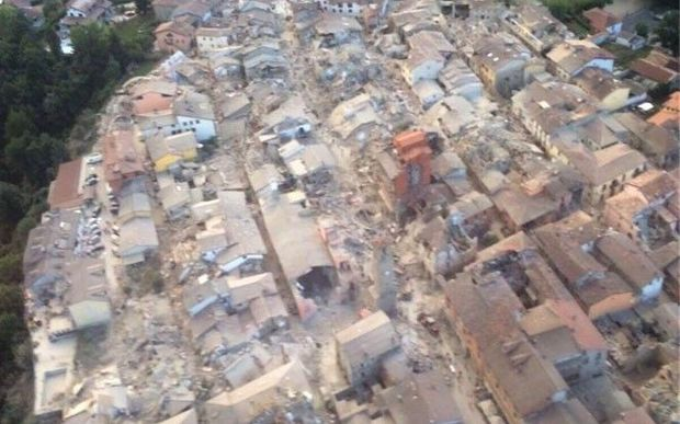 A handout picture provided by Vigili del Fuoco shows aerial view of damaged houses after the magnitude 6.2 earthquake has struck Amatrice region of Rieti, Italy on August 24, 2016. Vigili del Fuoco / Handout / Anadolu Agency