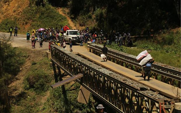 The travelling public is being forced to carry their belongings and cross by foot over one Kera Bridge.