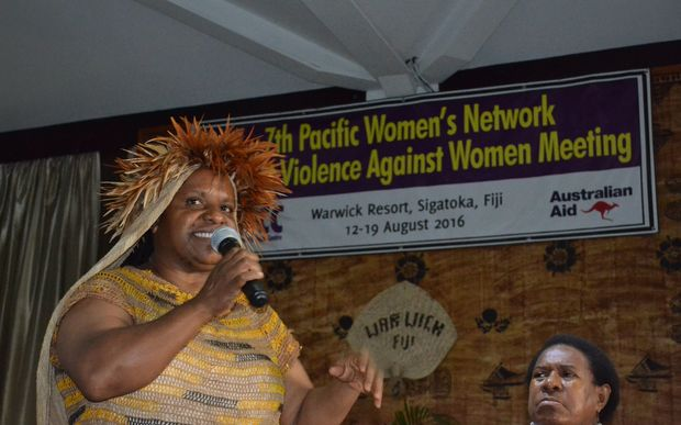 West Papuan human rights activist Rode Wanimbo address the 7th Pacific Women's Network Against Violence Against Women, while Bernadetha Mahuse looks on.