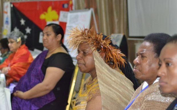 West Papuan human rights activists Rode Wanimbo (centre with headdress), Bernadetha Mahuse (second from right) and Ivana Yohana (right) seen with Merilyn Tahi (left, Vanuatu), Shamima Ali (second from left, Fiji) and Ofa Likiliki (Tonga).
