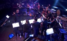 Mark Almond and musicians performing in the BBC Proms David Bowie tribute.