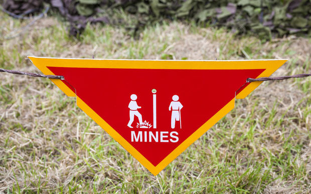Land mine warning sign