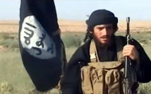 A screenshot from a video uploaded to YouTube in 2012 shows Abu Muhammad al-Adnani speaking next to an Islamic State flag at an undisclosed location.