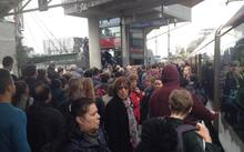 Hundreds of train commuters wait at Kingsland station after a fault caused widespread delays.