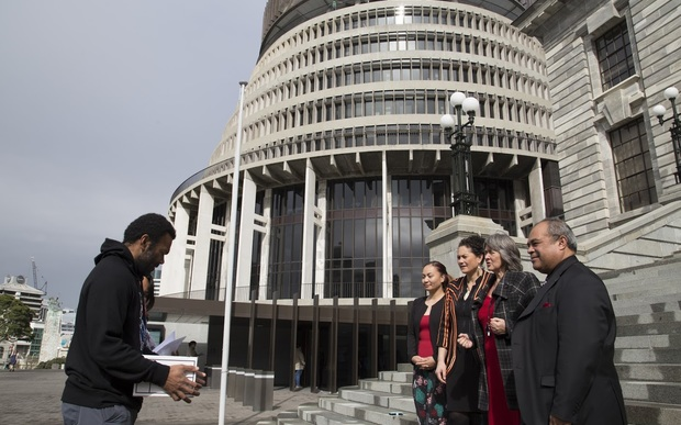 Pala Molisa and Tere Harrison present a petition on West Papua to New Zealand MPs Marama Davidson, Lousia Wall, Catherine Delahunty and Su'a William Sio, outside the country's parliament. 6 September 2016.
