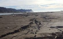 The recent 7.1 magnitude earthquake left large cracks in the sand at Rangitukia Beach near Te Araroa.