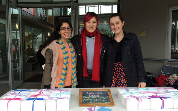 Nikita Kapoor (L) and Sacha Baillie (R) of Feel Good Period, with Bevan Chuang (C) at the Wesley Market.