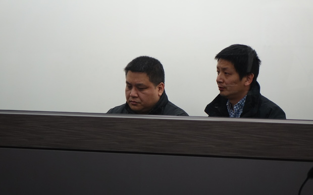 Limin Ma, left, with an interpreter at his sentencing for careless driving causing death in the Dunedin District Court on 7 September 2016.