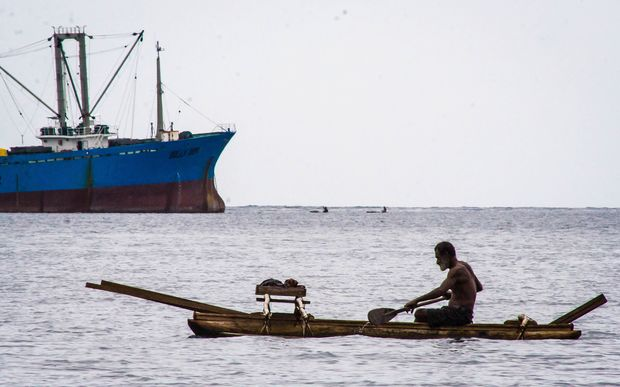 Large-scale and small-scale fishing in the waters off Madang in Papua New Guinea.