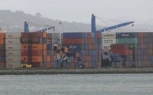 Containers have toppled over in strong winds in Centreport, on Wellington harbour.