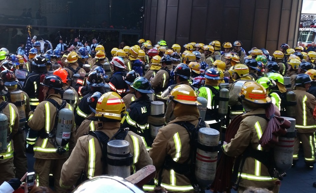 About 160 firefighters gathered to climb Auckland's Sky Tower in commemoration of the firefighters who died during 9/11.